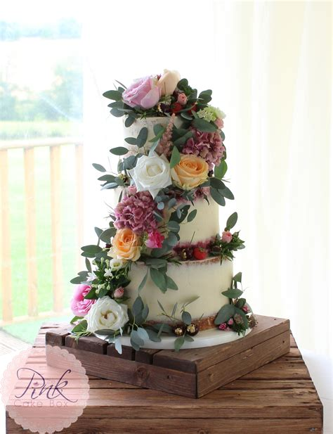 how to make a fresh flower wedding cake topper ehow semi naked wedding cake with fresh flowers wedding cakes