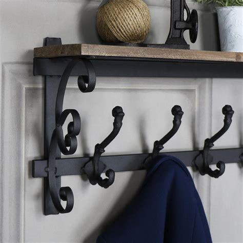 Ornate Wall Shelf by Ornate Wooden Wall Shelf With Coat Hooks Browne