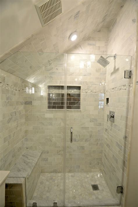 tiny bathroom remodel features carrara marble shower with