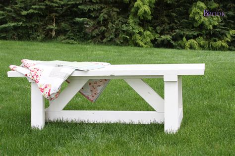 how to make a bench out of wood pallets bright white painted wooden bench at outdoor area which is