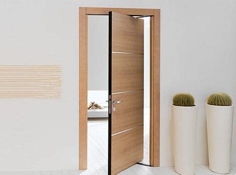 space saving double swing doors pivot on hidden hinges