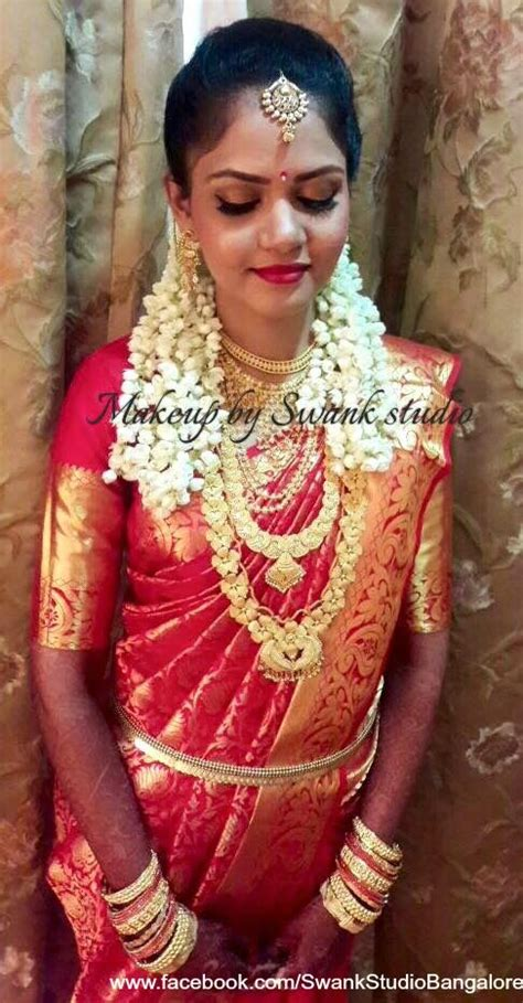 hairstyle design for saree traditional southern indian bride sarojam wears bridal