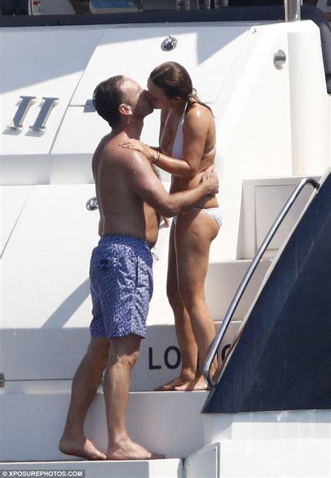 boat horn girl geri halliwell wears a white bikini with husband christian