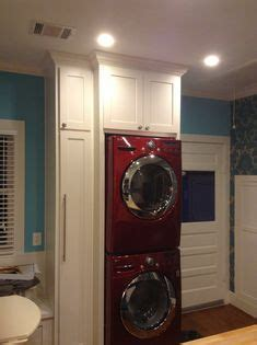 stacking washer dryer images laundry cupboard washer dryer laundry room storage
