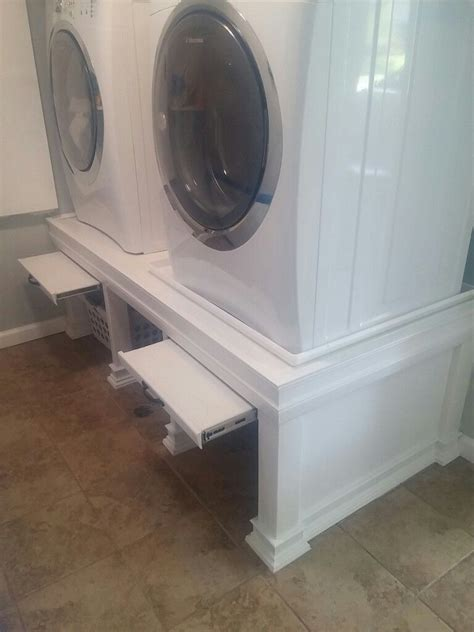 laundry pedestal design oh this is awesome a place to put a laundry basket while