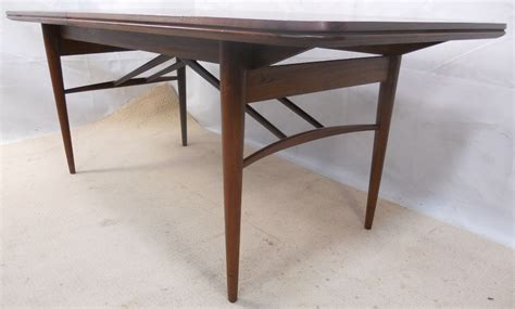archie shine teak extending dining table to seat ten