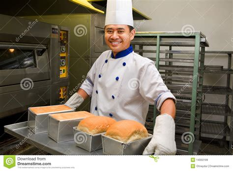 Oven The Baker baker holding fresh bread from oven stock image image