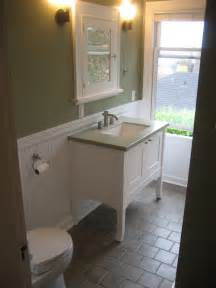 Full bathroom remodel cabinet tile and wainscot built to enhance