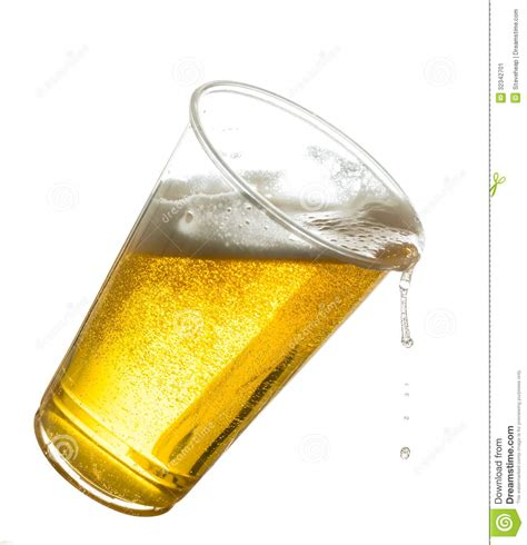 glass spilling golden lager or beer in disposable plastic cup stock image