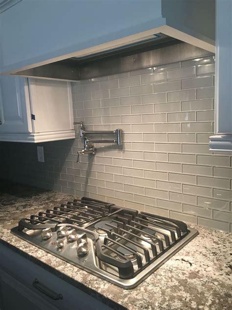 glass kitchen tile backsplash bianco antico granite mist glass tile backsplash white cabinets 5 burner ge profile stove top