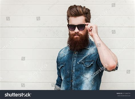 rugged and manly rugged manly confident bearded stock photo 311399774