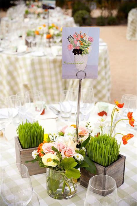 inspired wedding at brix restaurant and garden floral centerpieces orange