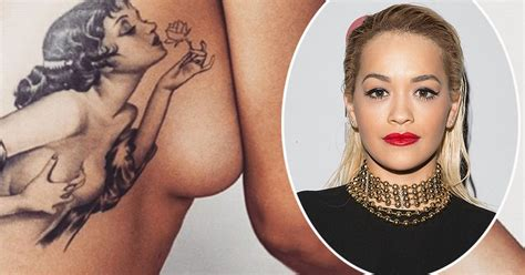 rita ora tattoos hey ora shows rib cage and a
