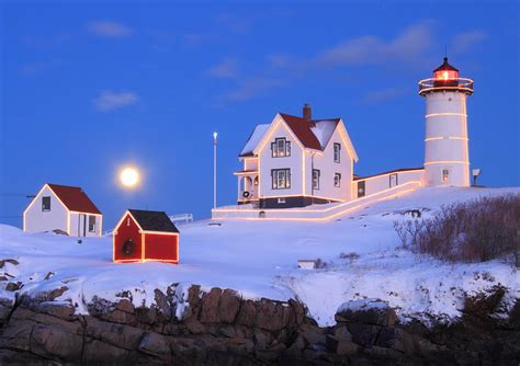 nubble lighthouse full moon and holiday lights photograph
