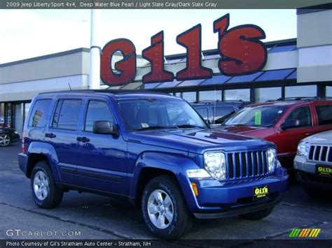light blue jeep liberty 2009 jeep liberty sport 4x4 in deep water blue pearl photo
