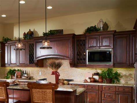 ideas for tops of kitchen cabinets ideas for decorating above kitchen cabinets lovetoknow