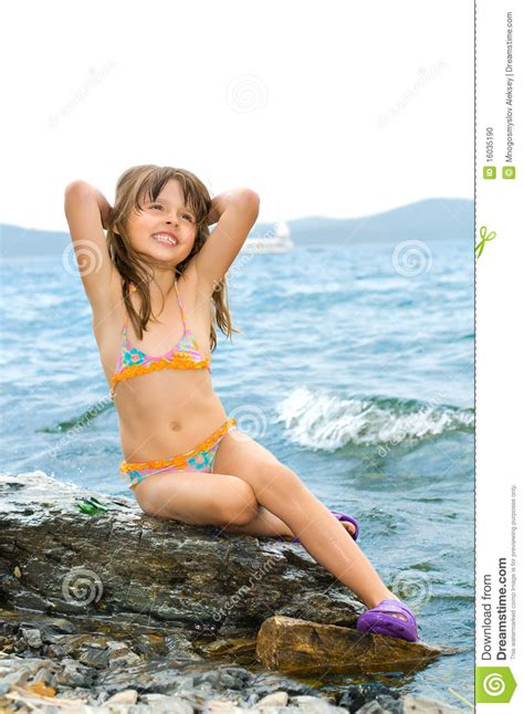 little young female models little girl stock photo image of rock nature lake