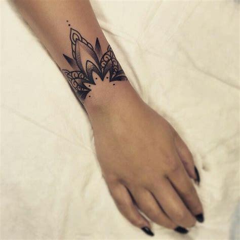 tattoo on wrist bracelet wrist tattoos 50 cool wrist tattoo designs for men and