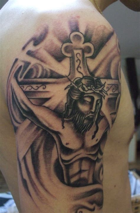 cross half sleeve tattoos cross and jesus grey ink on right half sleeve