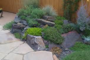 Backyard Rockery Retreat Traditional Landscape Landscape Lighting Ideas For Decks