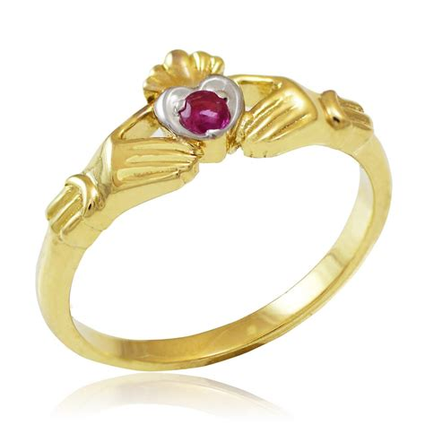 Ruby 9 05ct 0 05ct ruby promise claddagh ring in 9ct gold gold boutique