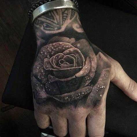 3d tattoo in hand 3d rose with water drops tattoo tattoo tattooed