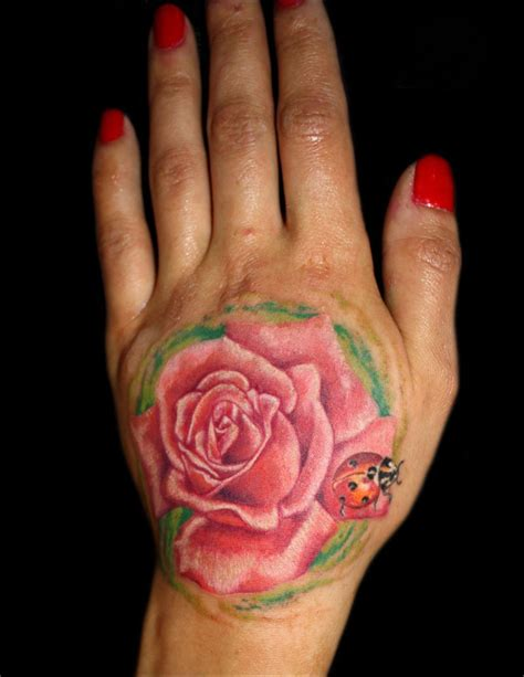 finger rose tattoo blue on