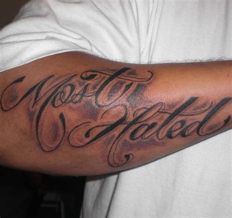 most hated black styled inscription forearm tattoo