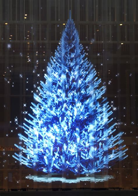 white christmas tree with blue lights happy holidays