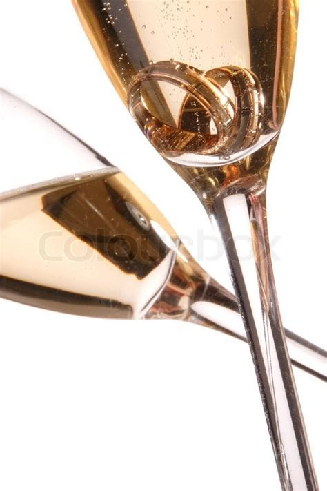Wedding rings in a glass of champagne   Stock Photo