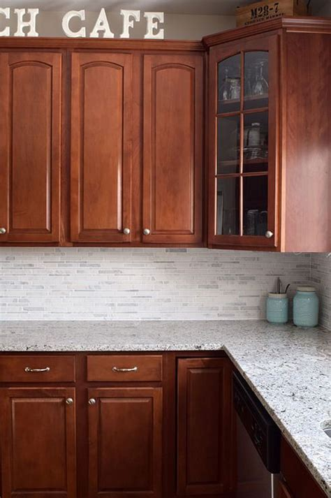 kitchen backsplash cherry cabinets kitchen makeover reveal cherries places and marbles