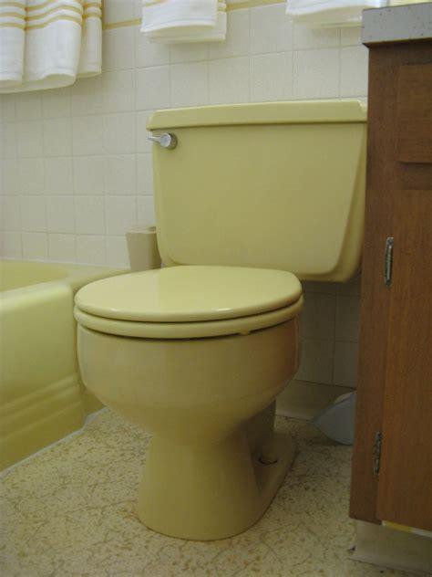 yellow bathroom suite kohler cimarron toilet gets retro renovation nod of