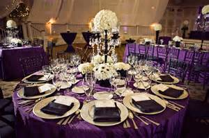 purple wedding decorations black white and purple wedding reception via weddingwoof the merry