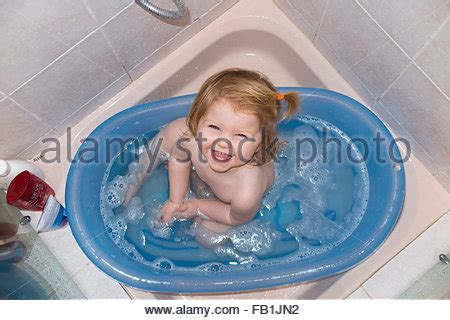 bathtub for 1 year old baby a toddler enjoying bubbles in the bath stock photo