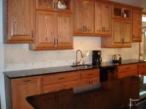 countertops with oak cabinets backsplash pictures with oak cabinets and uba tuba granite
