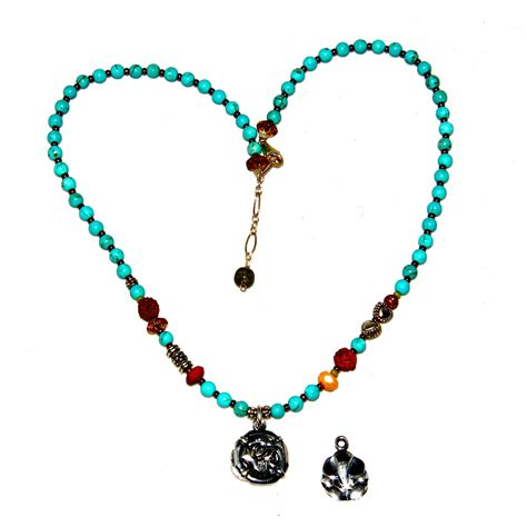 turquoise om ganesh necklace honoring the sacred