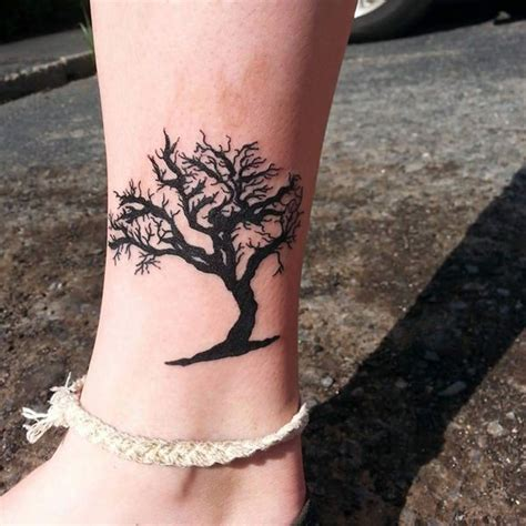 oak tree tattoo meaning black ink oak tree tatoo on side leg