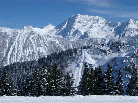 stock photo  steep alpine mountains covered