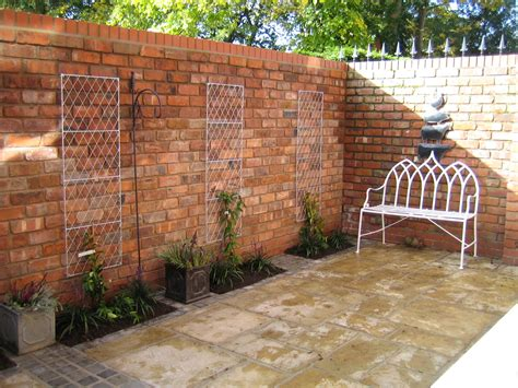 outside brick wall designs reclaimed brick walls in a small courtyard garden from a