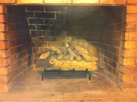 wood burning fireplace converted to gas no liner no cap