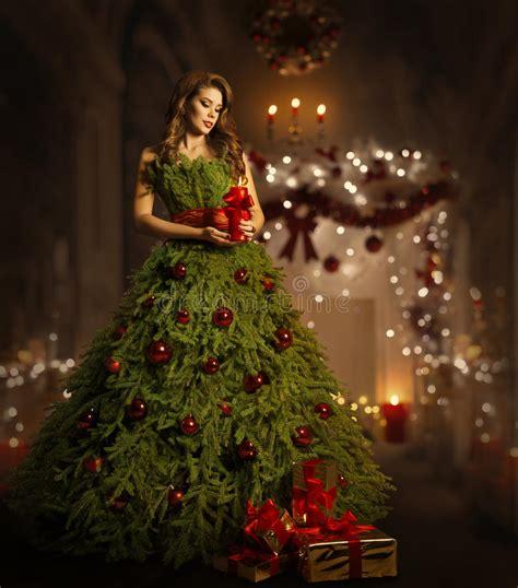 woman christmas tree dress fashion model in xmas gown