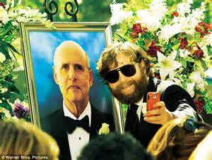 hangover actor with beard zach galifianakis looks debonaire as he cuts off beard and