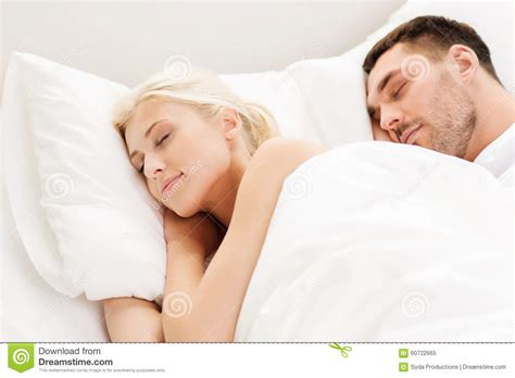 people in bed happy couple sleeping in bed at home stock image image