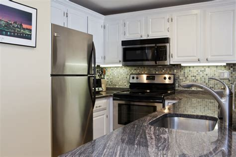 white kitchen cabinets stainless steel appliances condo near harvard kitchen centers and squares