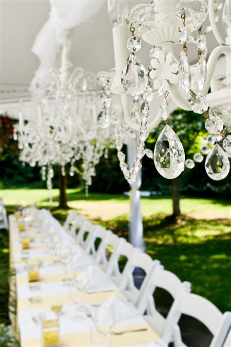 backyard summer wedding outdoor summer wedding with white reception tent and sparkling chandeliers onewed com