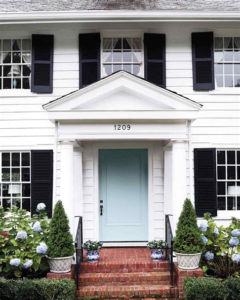 blue house with door tucker exterior paint colors on a colonial