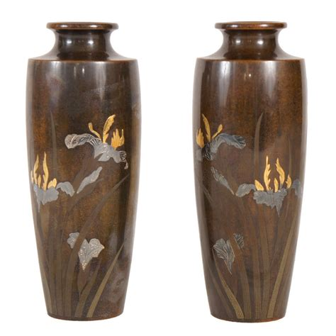 Gold And Silver Vase A Pair Of Japanese Bronze Vases Inlayed With