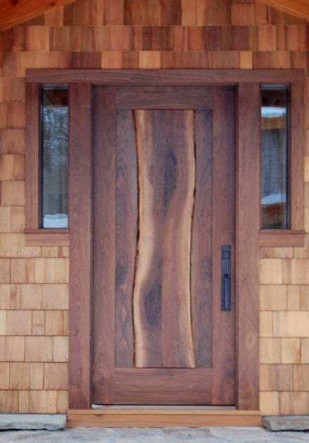Exterior Wood Door Slab A Thick Walnut Slab Complete With Live Edges Flows The Center Of The Entry Door On Dan