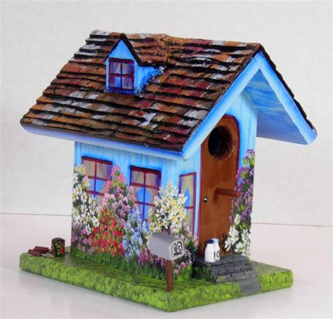 Handcrafted Birdhouses - blue birdhouse handcrafted painted and has a
