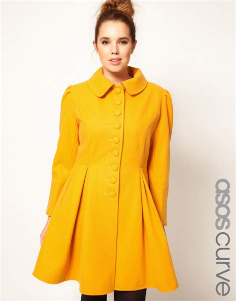 plus size swing coat lyst asos button swing coat in yellow